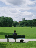 A Man Sits in the English Garden in Munich Photographic Print by Taylor S. Kennedy