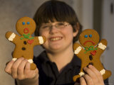 Gingerbread Cookies React to the Prospect of Being Eaten by a Boy Photographic Print by Joel Sartore