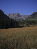 The Maroon Bells Jut Out of the Skyline Above an Empty Field, Aspen, Colorado Photographic Print by Taylor S. Kennedy