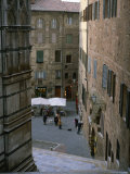 A Street Scene at the Foot of the Siena Cathedral Photographic Print by Taylor S. Kennedy