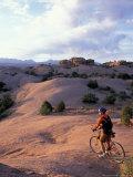 Mountain Biking on the Moab Slickrock Bike Trail, Navajo Sandstone, Utah, USA Fotografie-Druck von Jerry & Marcy Monkman