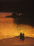 Canoers on Lake Metigoshe at Sunset, North Dakota, USA Photographic Print by Chuck Haney