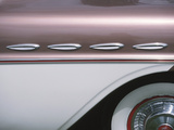 Sleek Chrome Decorations on Side of Pink Classic Car Photographic Print