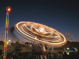 Spinning Carnival Ride at Night Photographic Print