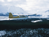 Plane Taking off from Snowy Landscape Photographic Print