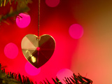 Precious Gold Heart Decoration Dangling from Christmas Tree Photographic Print