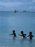 Children Swimming in the Sea, Martinique Photographic Print