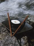 Elegant Sushi and Chopsticks Beside Rushing Water Photographic Print