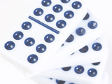 Pile of Black and White Dominoes Against White Background Photographic Print