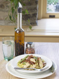 Glass of Water and Flavored Vinegar Oil with Tasty Plate of Pasta Fotografisk tryk