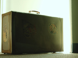 Vintage Suitcase Covered in Travel Tags Photographic Print