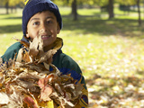 Little Boy with Leaves Photographic Print