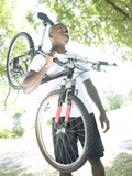 Man Carrying Bike Photographic Print