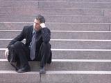 Dejected Business Sitting on Steps Reprodukcja zdjęcia