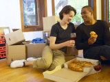 Couple Having Pizza and Red Wine in Empty Apartment Photographie