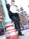 Business Man on City Street Reading Map Reprodukcja zdjęcia