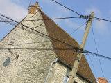 Power Lines Crisscrossing Antique Building Fotoprint