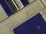 Close-up of Building Exterior with Purple Window Shutters and Door Fotoprint