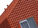 A Red Clay Tiled House with a Window Fotoprint