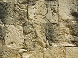 Close-up of a Cracked and Crumbling Stone Wall Photographic Print