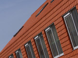A Red Clay Tiled House with a Row of Windows Fotoprint