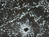 Close-up of a Hole in Cracked and Shattered Glass Photographic Print