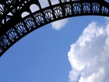 A Detailed Arch on the Eiffel Tower Against Blue Sky and Clouds Photographic Print