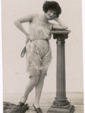 Lady in Her Undies and Gartered Stockings Leans Cheekily on a Pillar Photographic Print