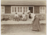 Lady Golfer Prepares to Putt as Two Seated Spectators Watch Photographic Print