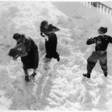 Three Young People Enjoying a Snow Fight Photographic Print