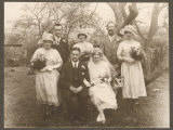 Small Wedding Group Consisting of the Bride and Groom Photographic Print
