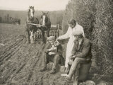 Two Farmers Take a Welcome Break from Ploughing and a Kindly Woman Pours One of Them a Drink Photographic Print