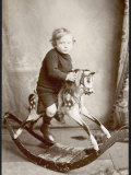 Little Boy on a Rocking Horse Photographic Print
