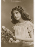 Accept I Beg an Easter Egg, a Pretty Girl Offering Easter Eggs from a Basket Photographic Print