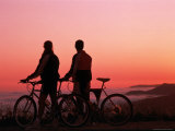 Silhouette of Two Cyclists at Sunset Photographic Print by Paul Meyer
