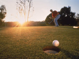 Man Hitting Golf Ball Photographic Print
