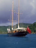 Yacht at Sea Near Coast, Antigua Photographic Print by Timothy O'Keefe