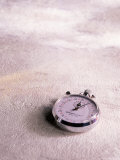 Stopwatch on Light Textured Background Photographic Print by Greg Smith