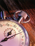 Stopwatch on Wood Background Photographic Print by Greg Smith