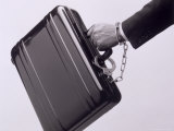 Briefcase with Hand Cuffed to It Photographic Print by Howard Sokol
