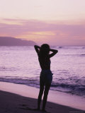 Woman Standing on Beach in Silhouette Photographic Print by Bill Romerhaus