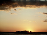 Sunset Over Water with High Clouds Photographic Print by Guy Crittenden