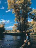Woman Fly Fishing in Co, Holding Fish Photographic Print by Paul Gallaher