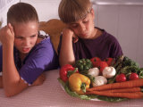 Children Having Negative Reaction to Healthy Food Photographic Print by Nancy Richmond
