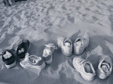 Four Pairs of Shoes on the Sand Photographic Print by Mitch Diamond