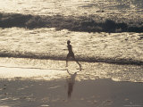 Boy Running on Beach, Venice Beach, CA Photographic Print by Harvey Schwartz