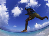 Man Jumping with Waters and Blue Photographic Print by Guy Crittenden