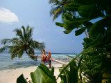 Couple on Beach, Felidu Atoll, Maldives Photographic Print by Stuart Westmorland