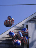 Flag Balloons Flying Out of a Small Door Photographic Print by Gary D. Ercole