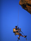 Rock Climber Hanging off Cliff Photographic Print by Greg Epperson